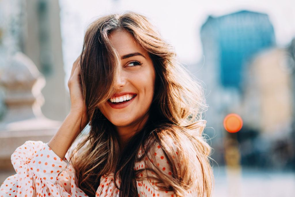Happy woman with wavy hair