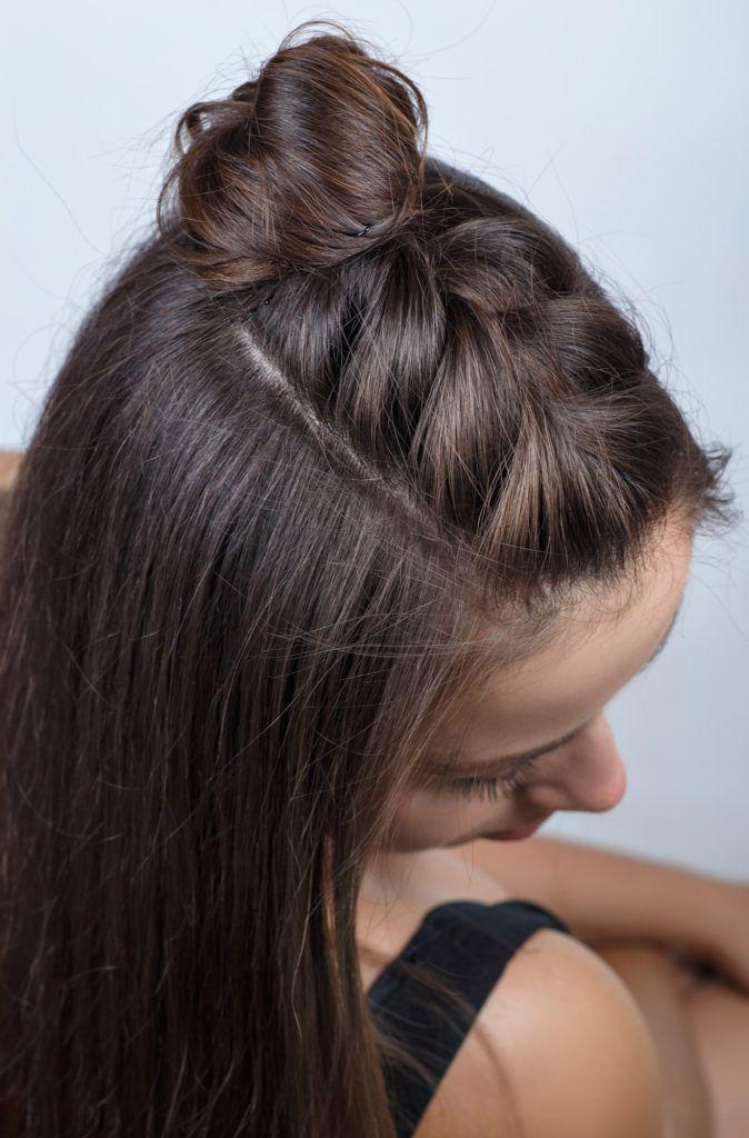 Model rambut half braid bun half updo.