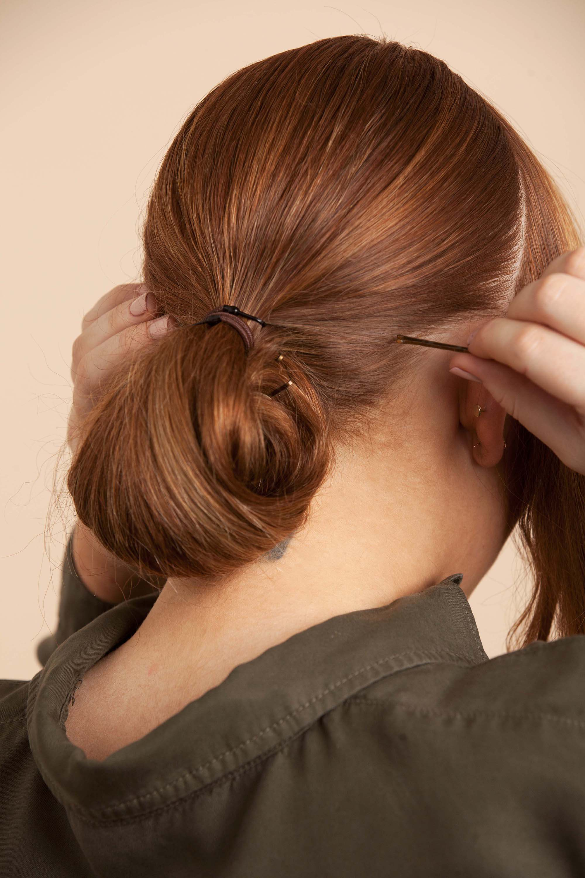perfect chignon step 7 secure with pins
