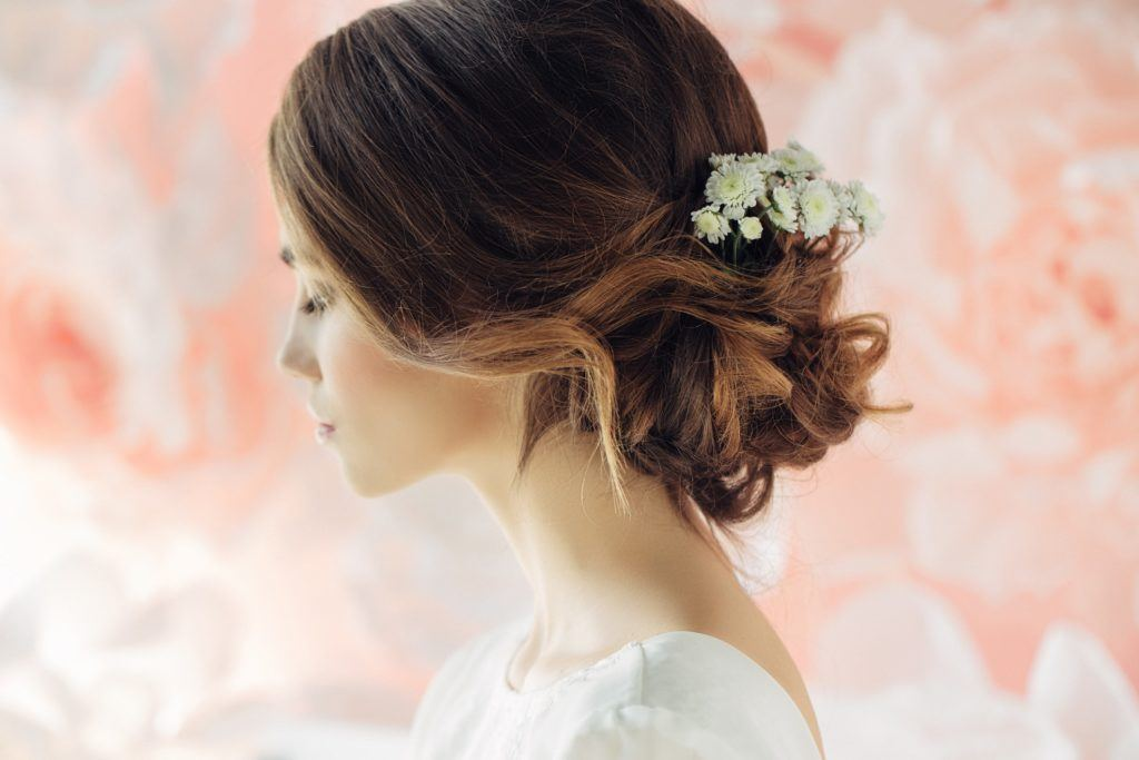 evening hairstyles low updo flowers