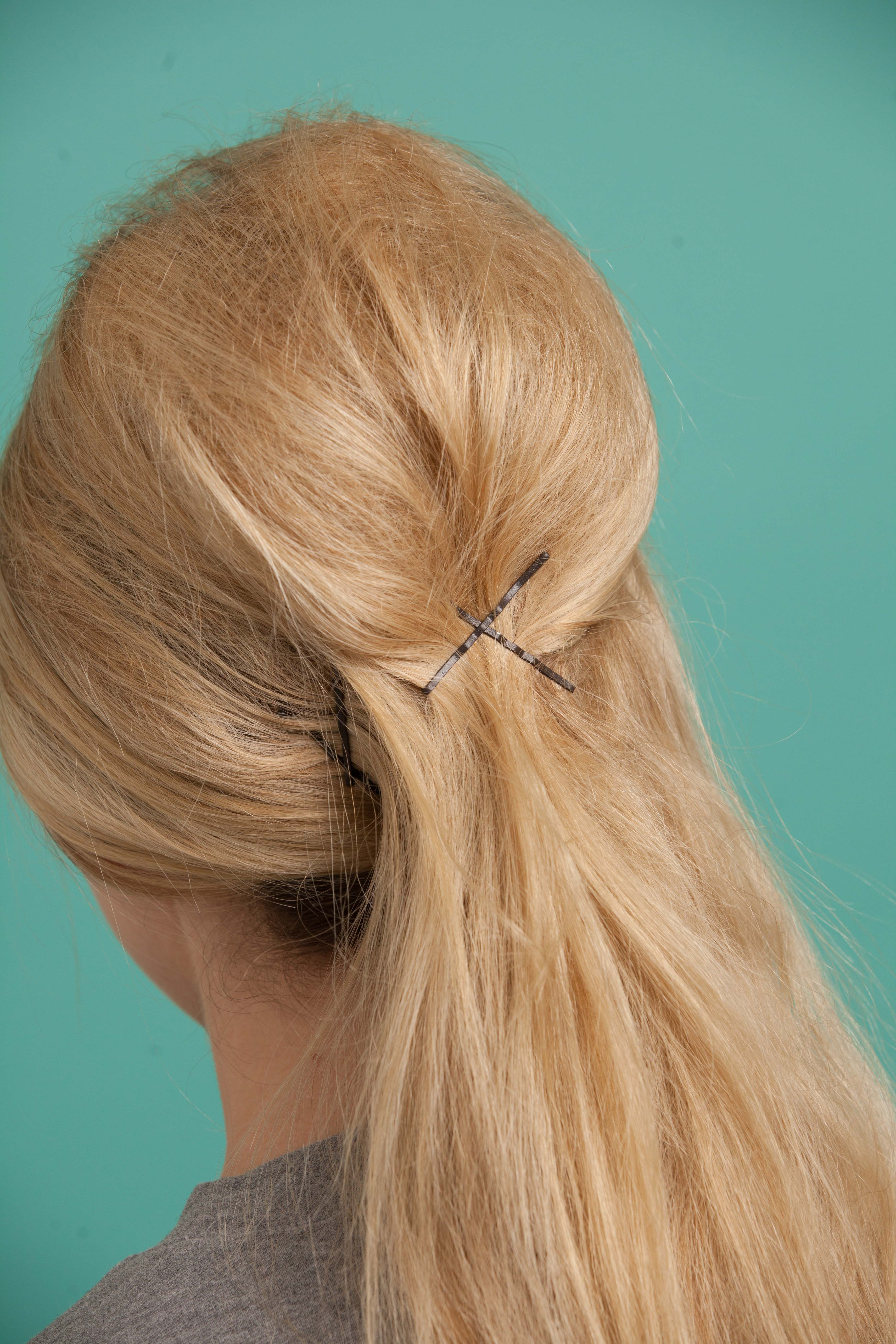 French twist secured with more bobby pins on crown