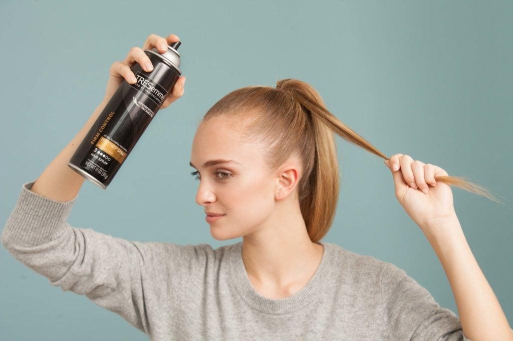Set hair with hairspray