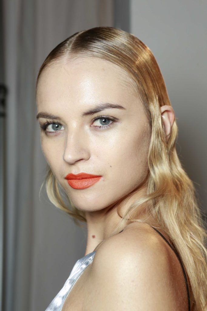 best summer hair color for your skin tone sleek blonde wet look