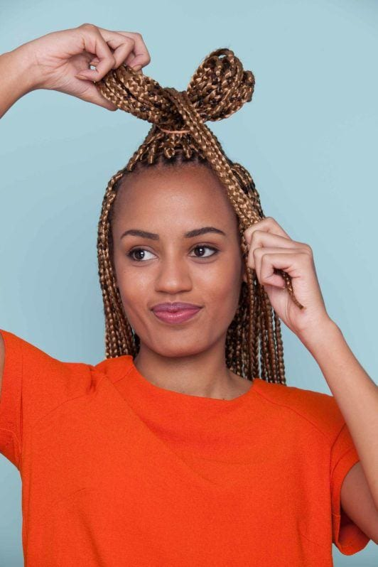 a bow bun on styles with box braids