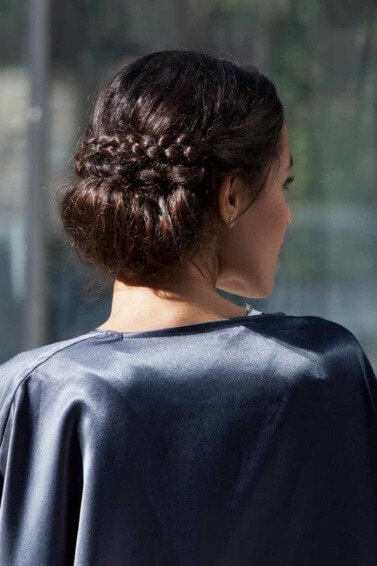 a rear view of updos for medium-length hair greek bun for a woman