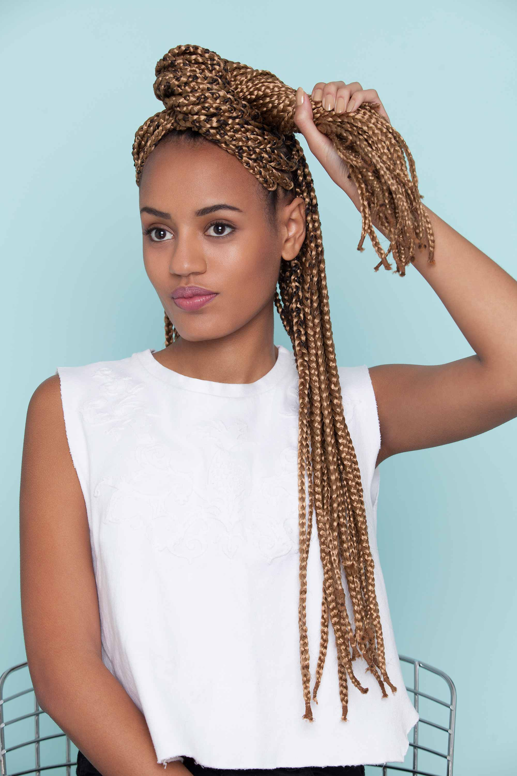 styles with box braids twisted into a loop