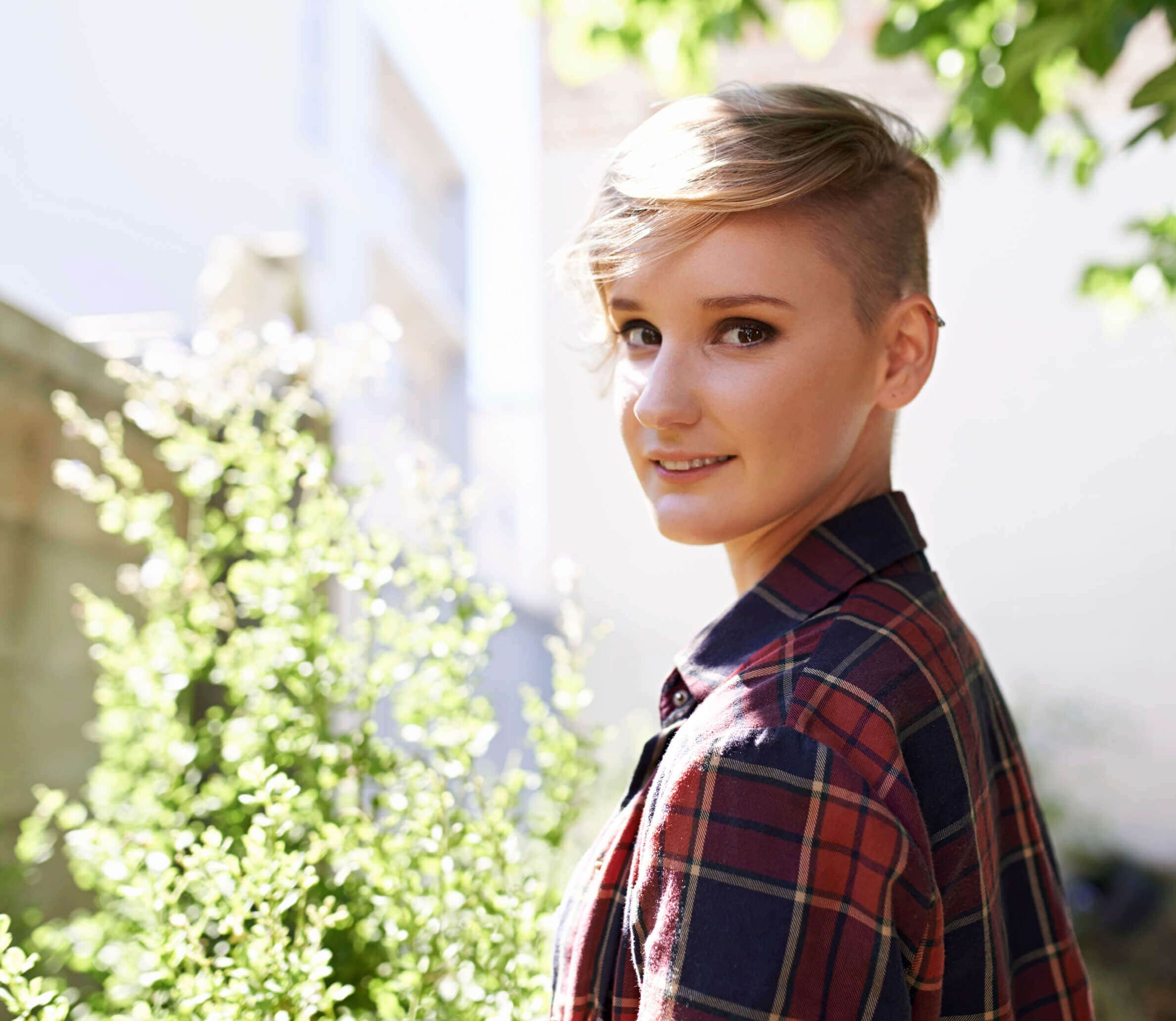 young woman with blonde pixie, one of the hottest women's shaved hairstyles