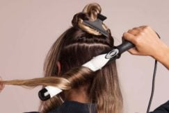 using a curling iron on a long bob to create waves