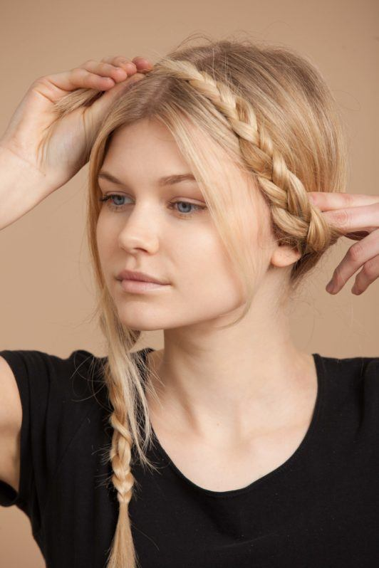 twist one braid across your crown to create the milkmaid braids
