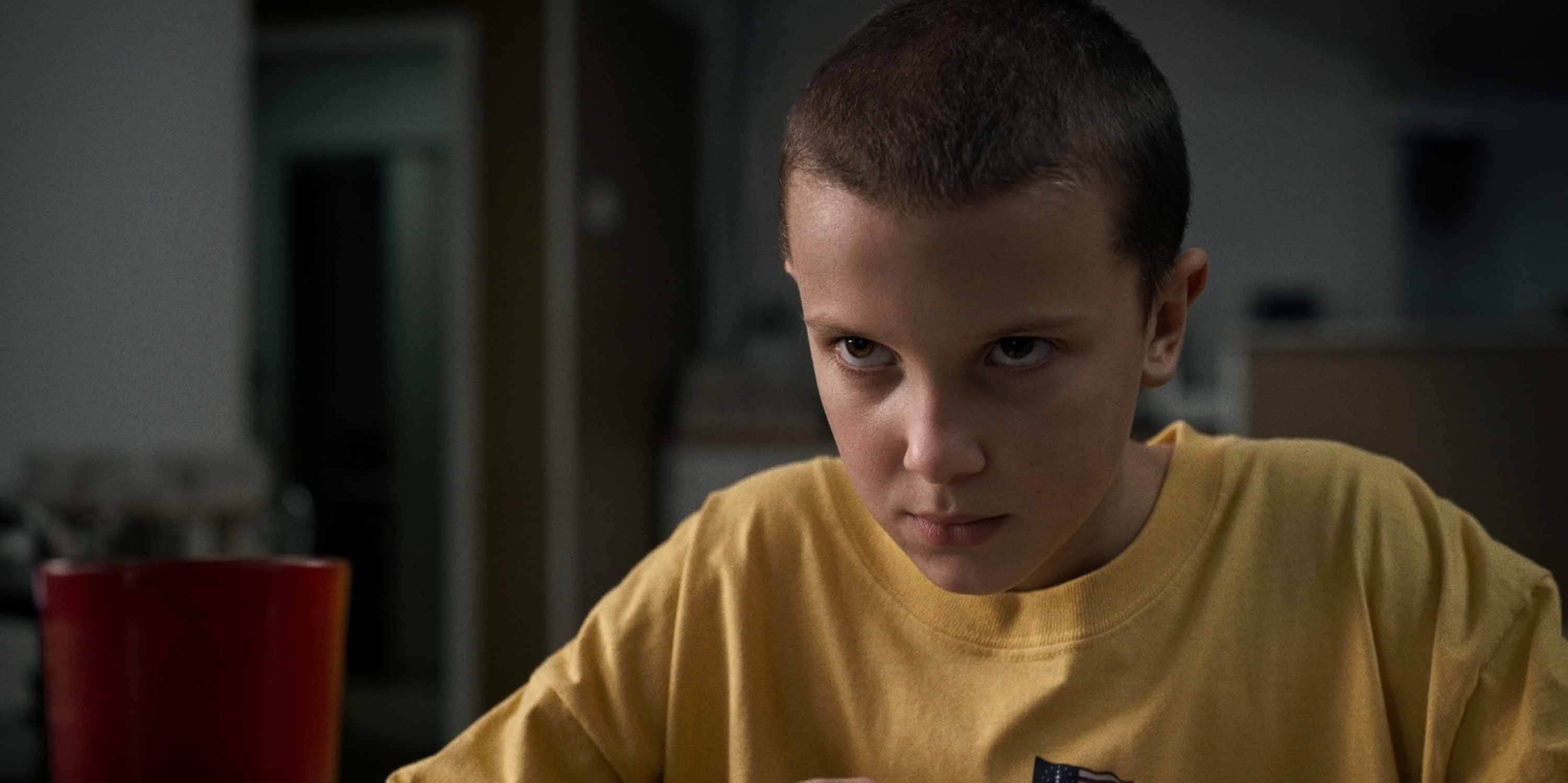 80s hair stranger things eleven buzzcut