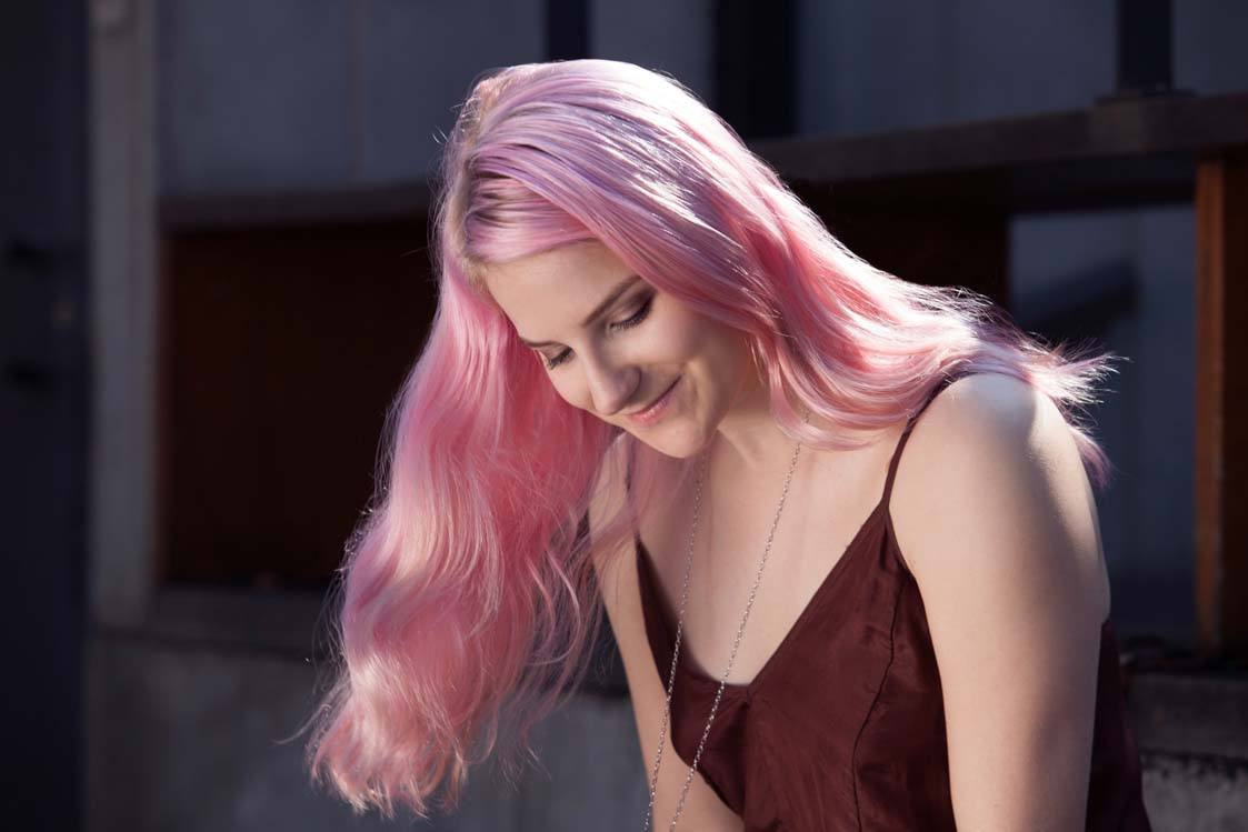 light pink hair dye with a mermaid hairstyle