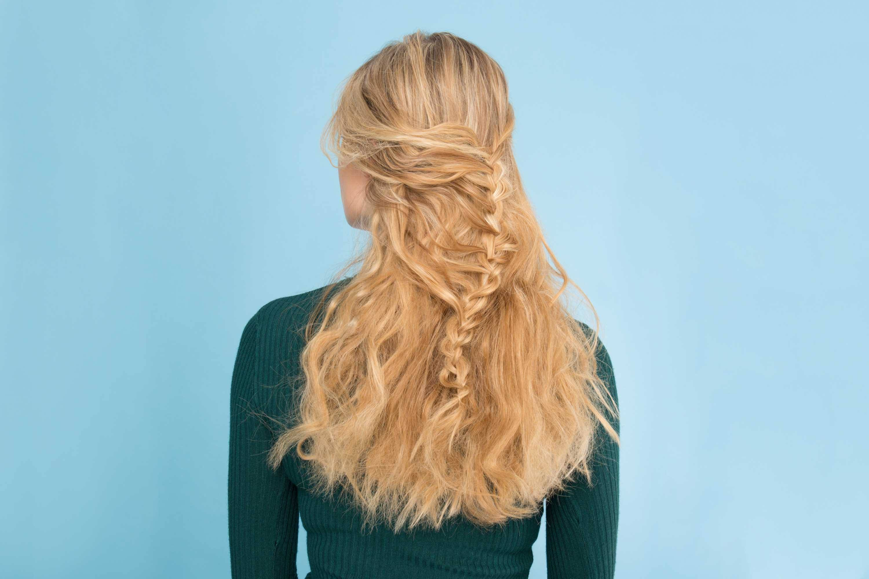 woman wearing funky braid hairstyles on long wavy blonde hair