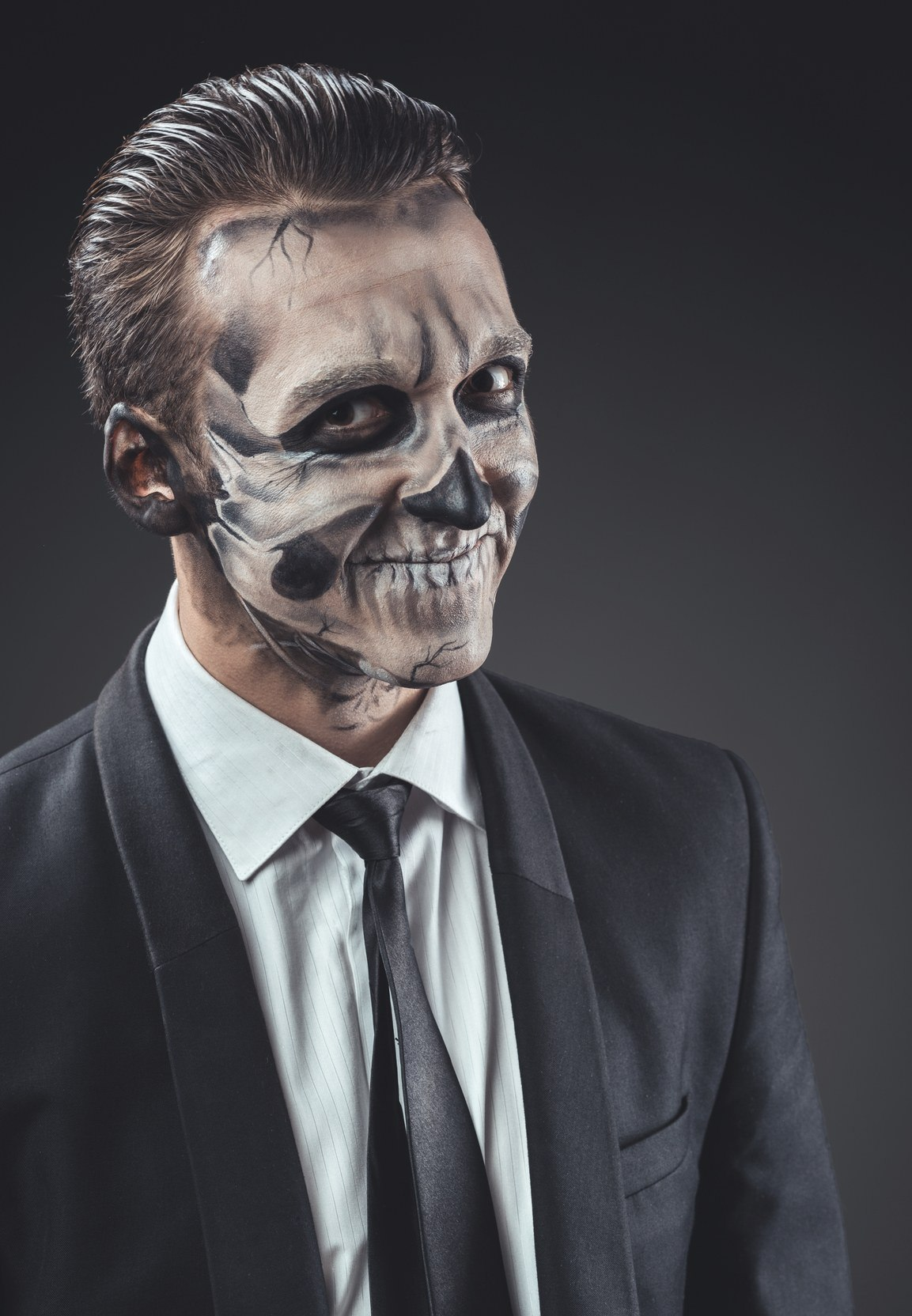 man wearing zombie costume with slicked back hairstyle