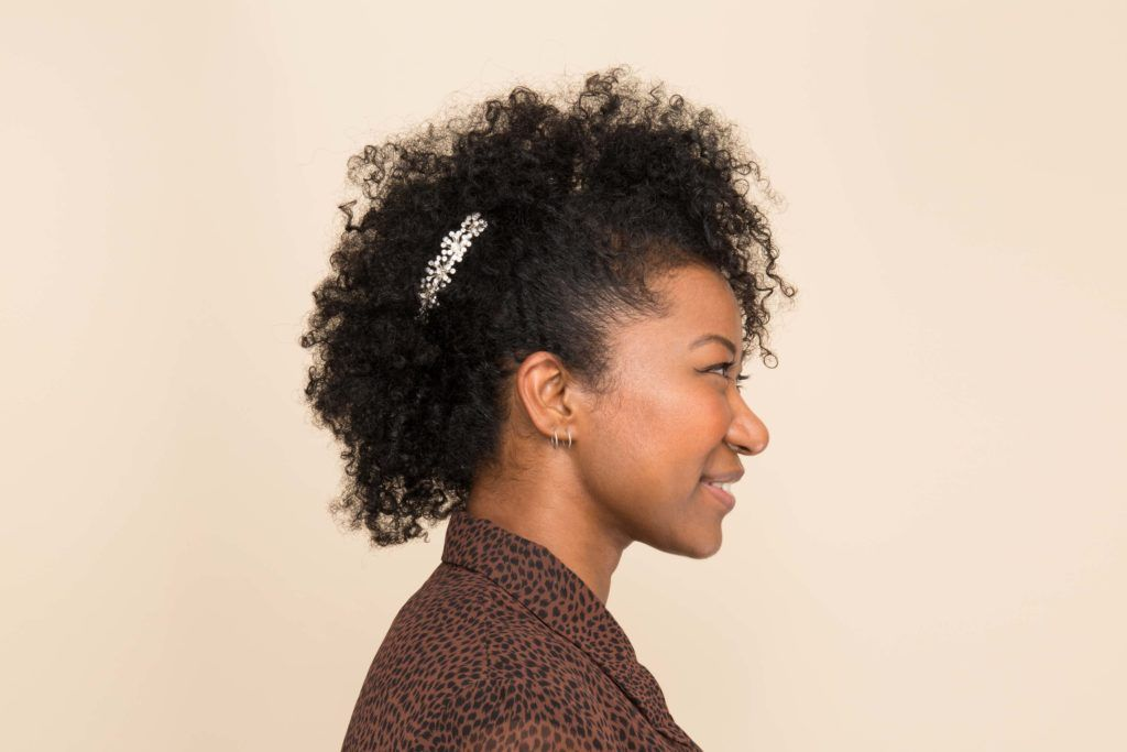 an afro woman with mohawk hairstyle side view