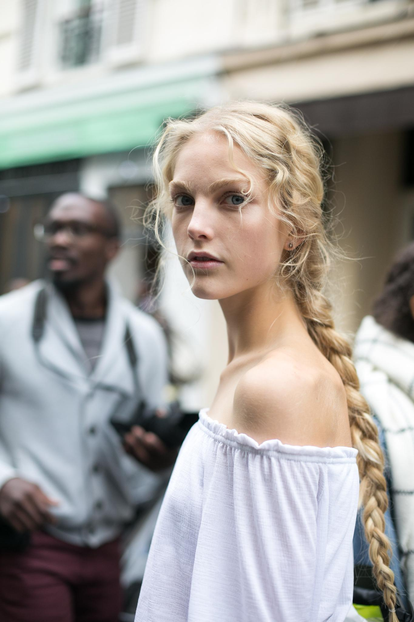 young model wearing braid on long naturally wavy hair