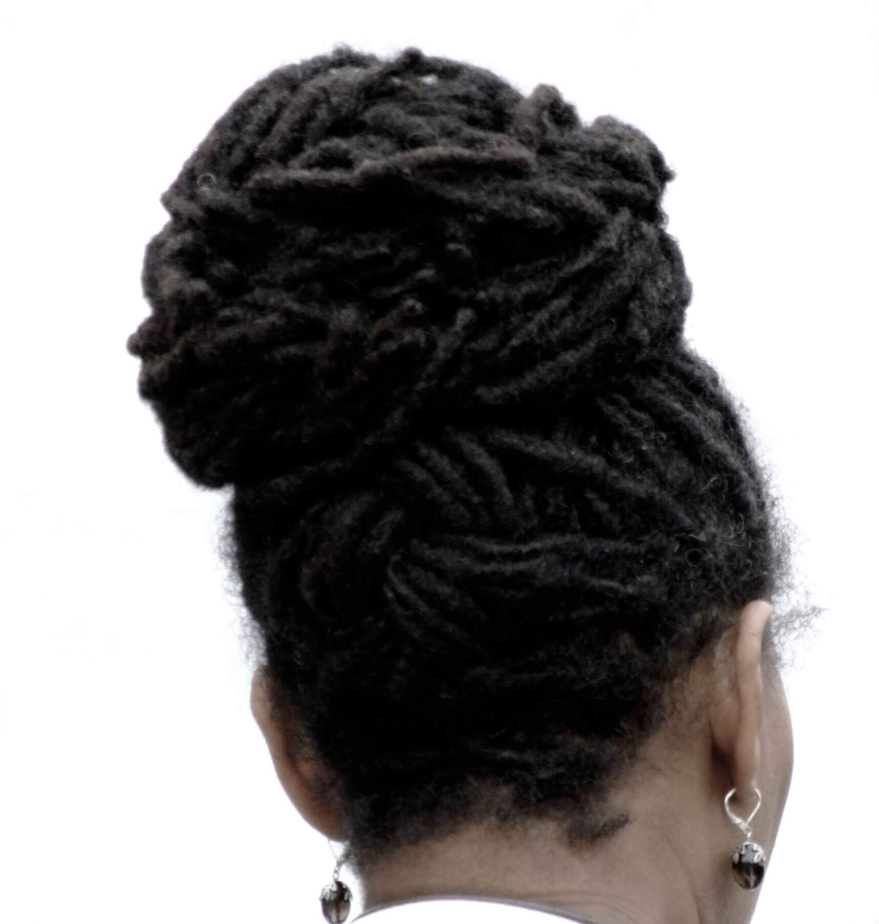 dreadlock hairstyles top knot