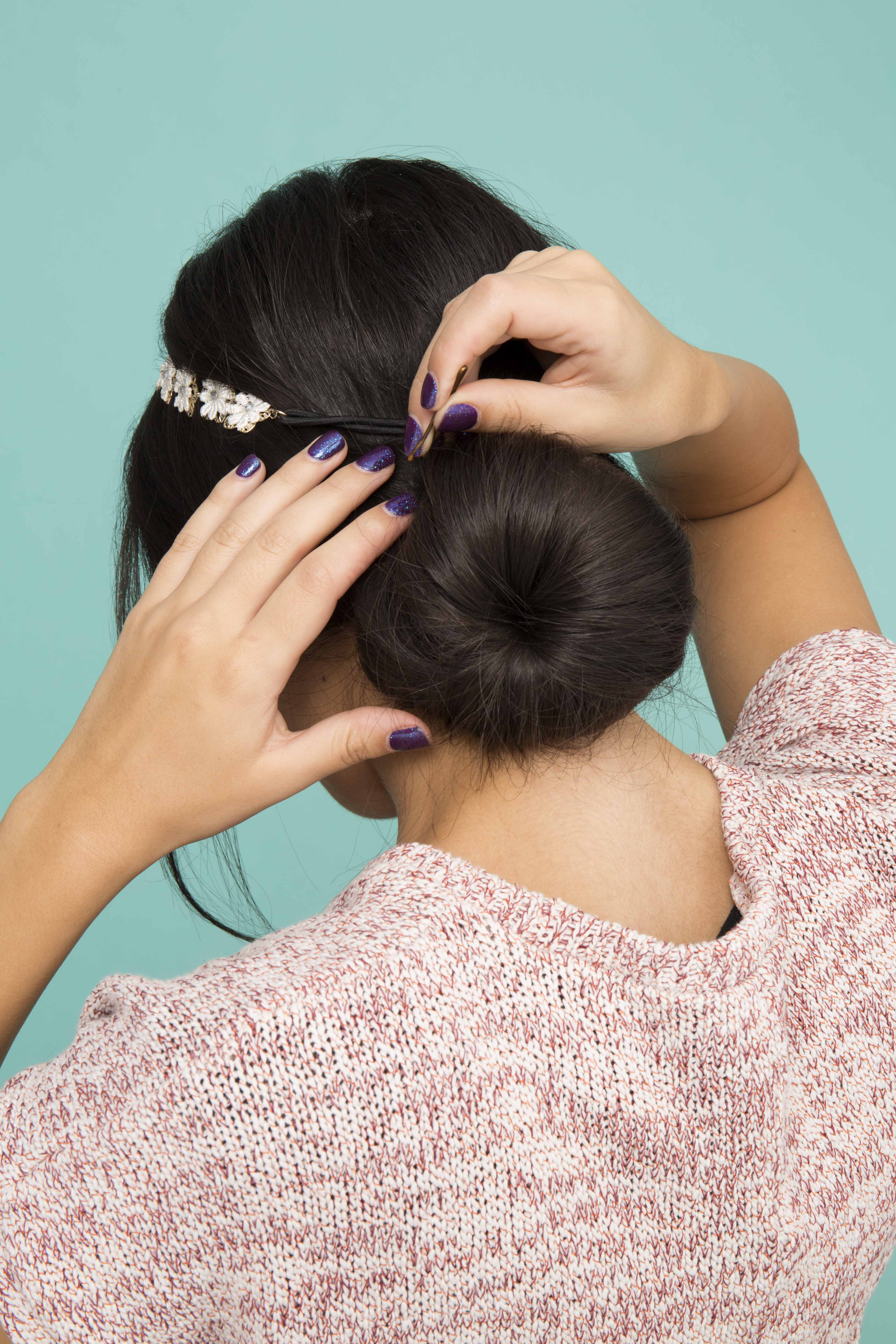 accessorized low chignon bun