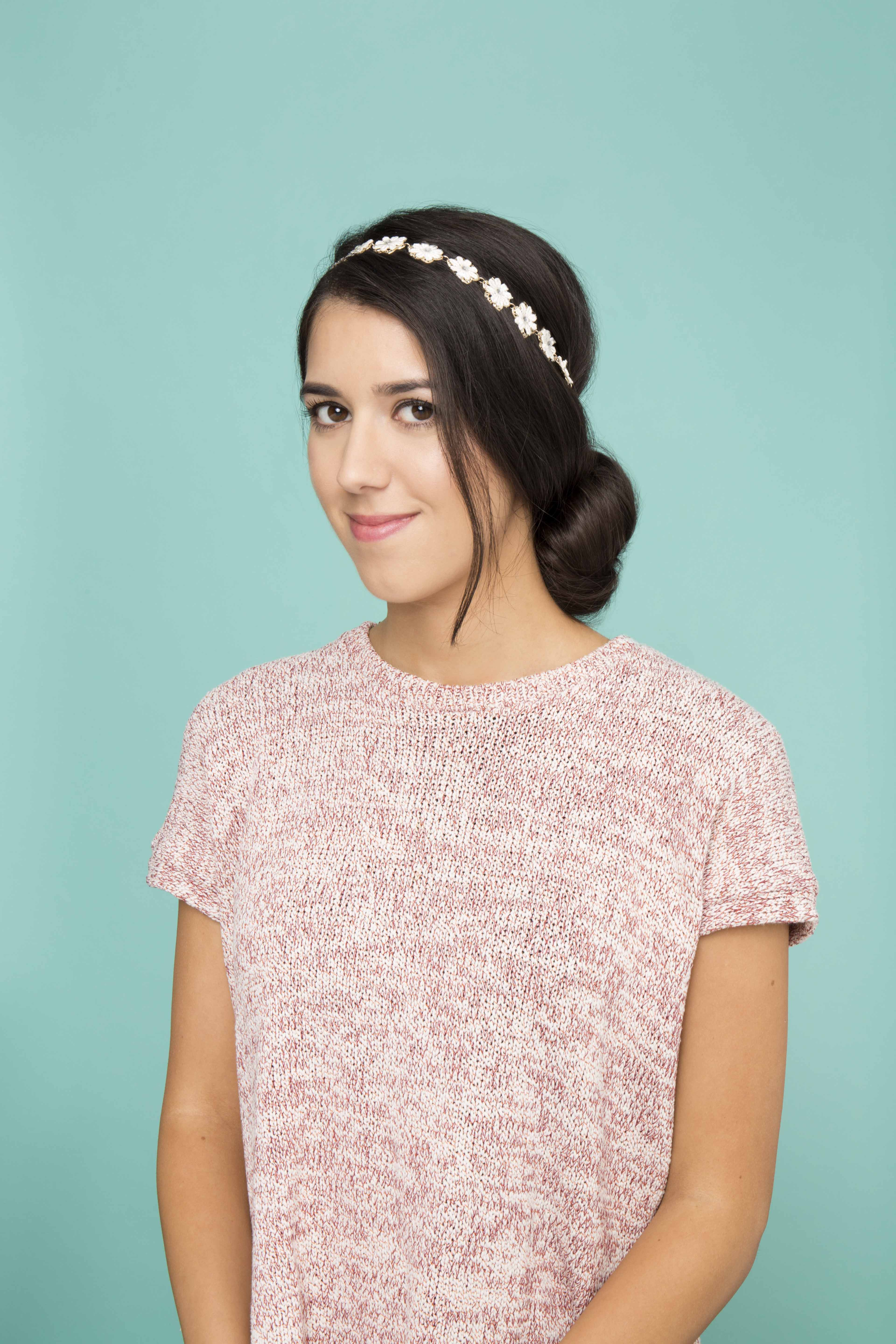 accessorized low chignon dark hair