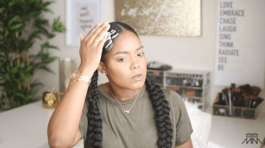 mini marley applies mousse to her braided hairstyle
