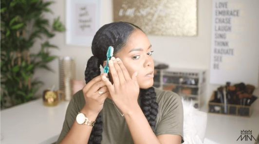 mini marley tames the hairline of her braided hairstyle