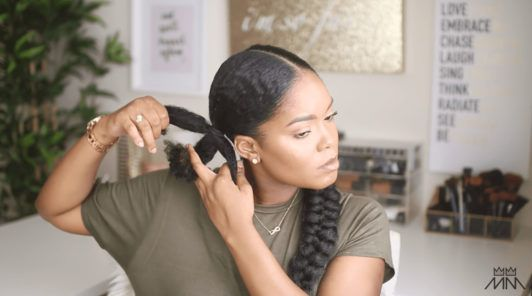 mini marley divides her braided hairstyle into sections