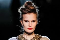 young model with French roll hairstyle date night hair ideas