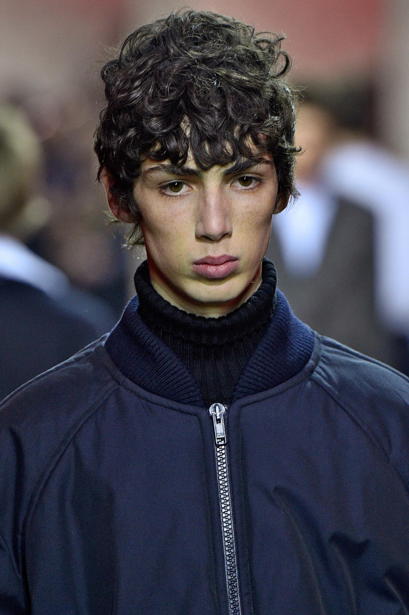 young model with fringe haircuts style on curly hair