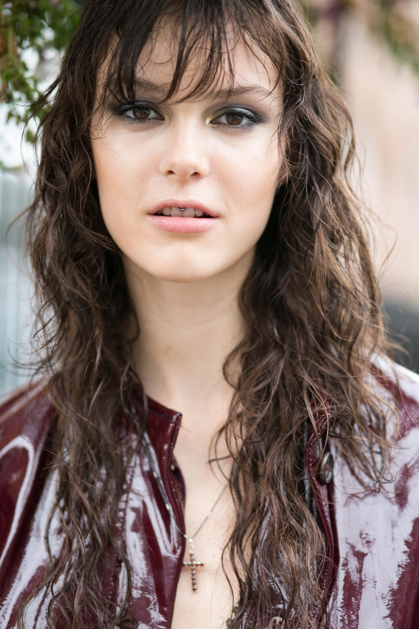 Brunette woman with natural waves wearing wet style