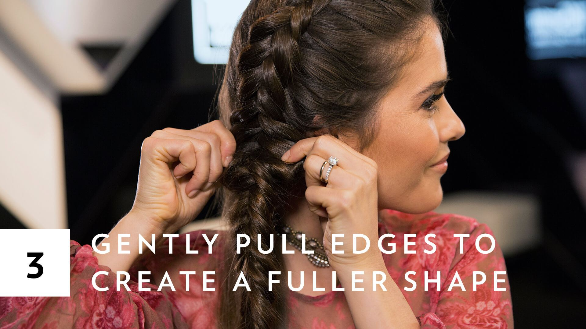 blogger Paola Alberdi from Blank Itinerary pulling mermaid braid to create fuller look