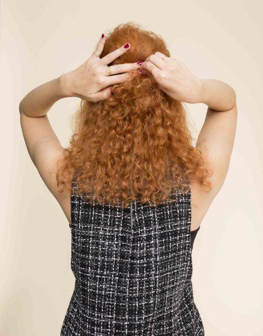 pin hair back to create a mini bouffant hair tutorial