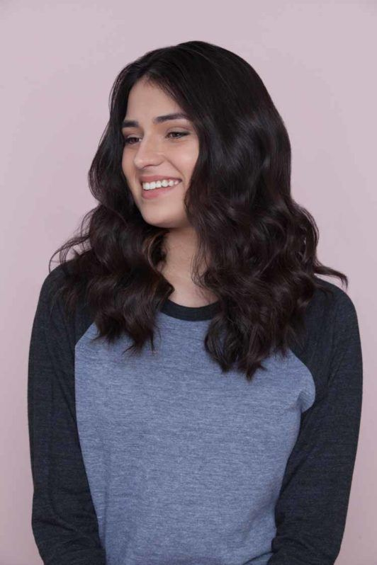 woman posing with wavy hair hairstyle