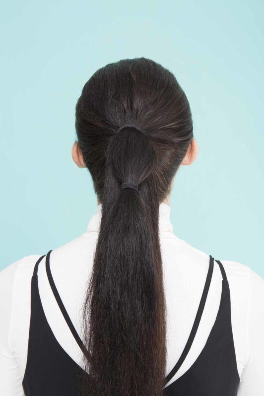 young lady with long black hair with bubble pony