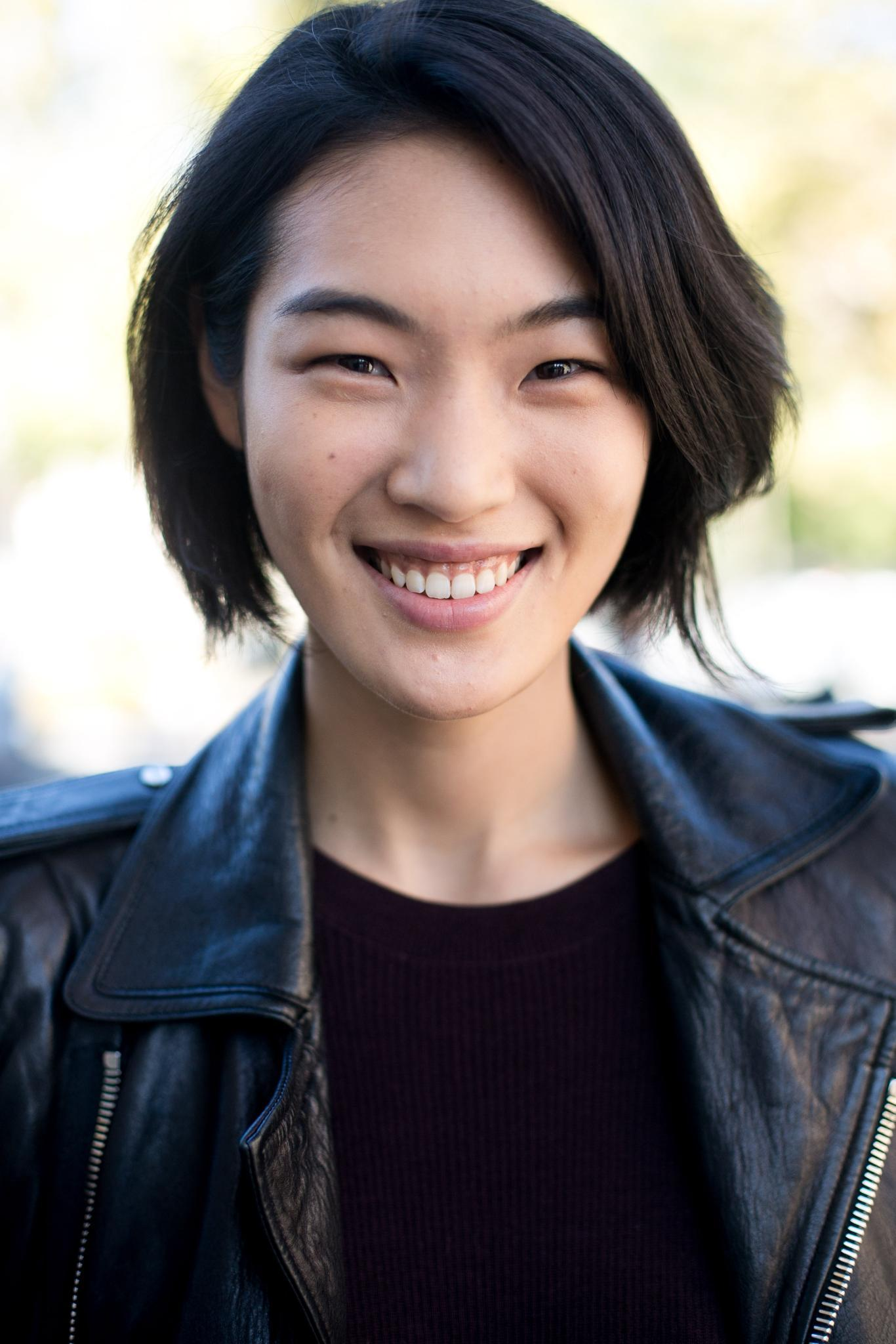 young Asian woman with feathered bob haircut