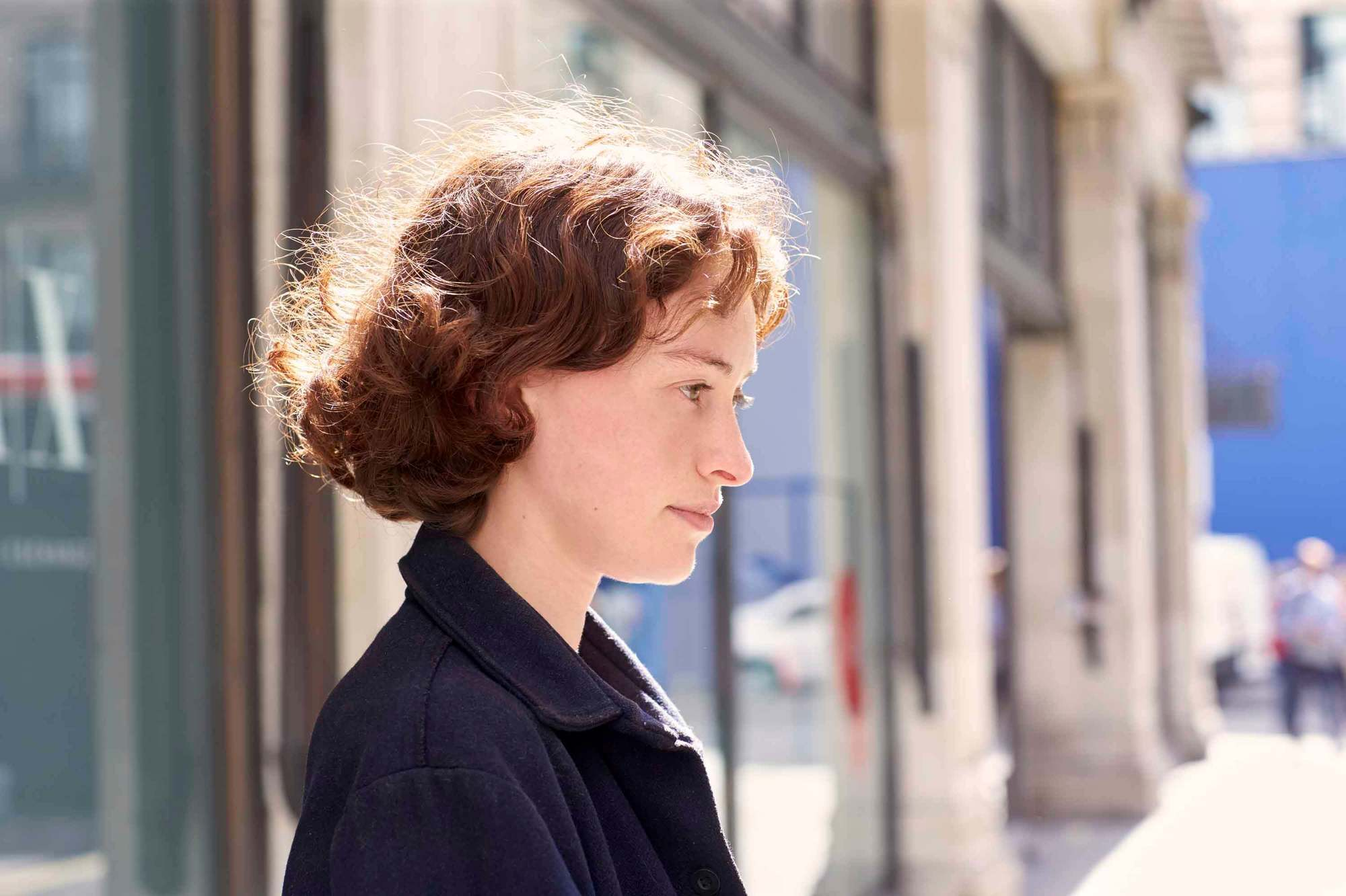 Brunette woman with curly hair bob