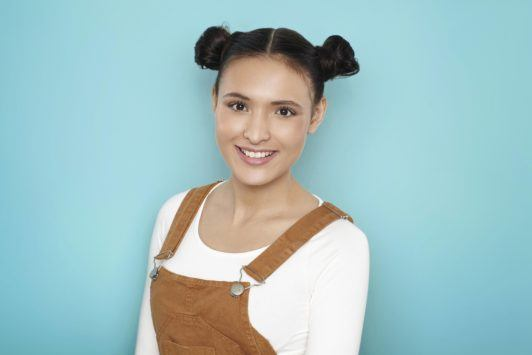 young woman wearing space buns hairstyle