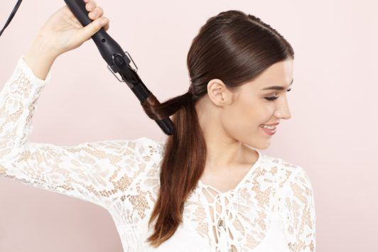 create curled ends in your unicorn braid ponytail