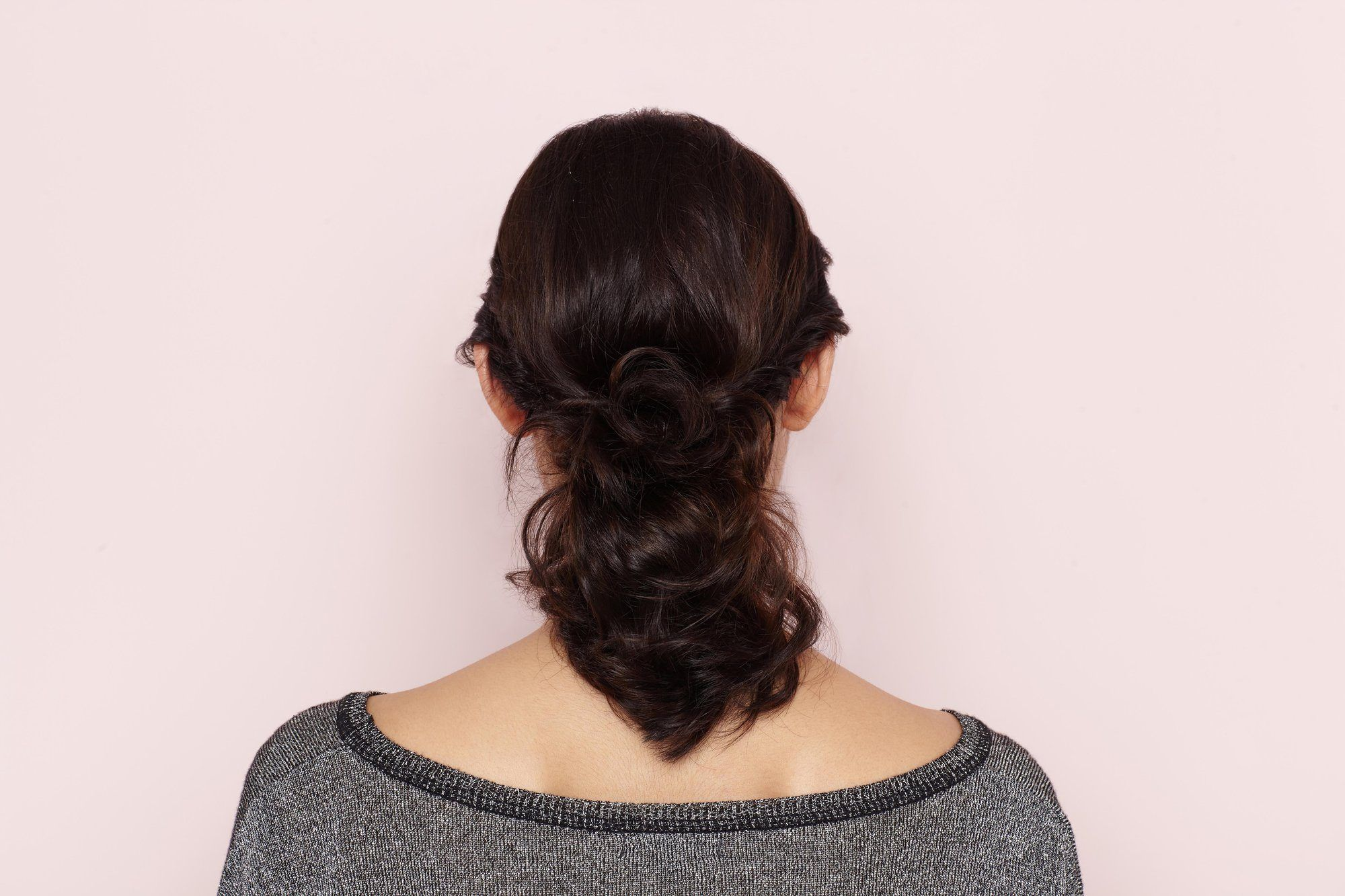 curling wand styles on a curly ponytail hairstyle