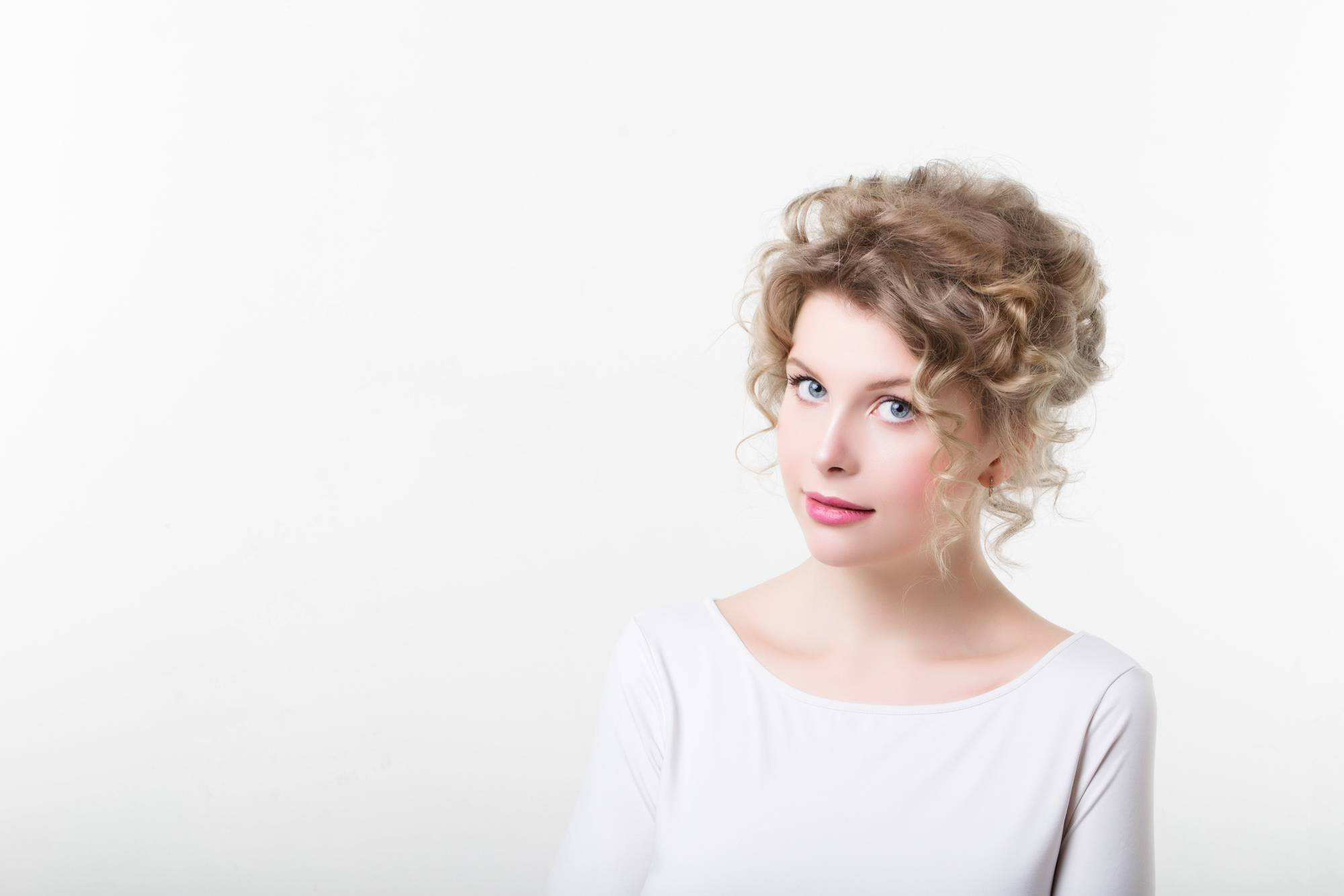 Curly Hairstyles For Thin Hair include effortless updos.