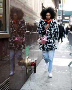 woman wearing furs and curls trend during NYFW