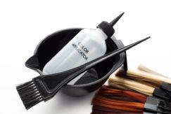 Professional salon color tools - color swatches, mixing bowl and application brush for hair dye or colored highlights hair dyeing tips
