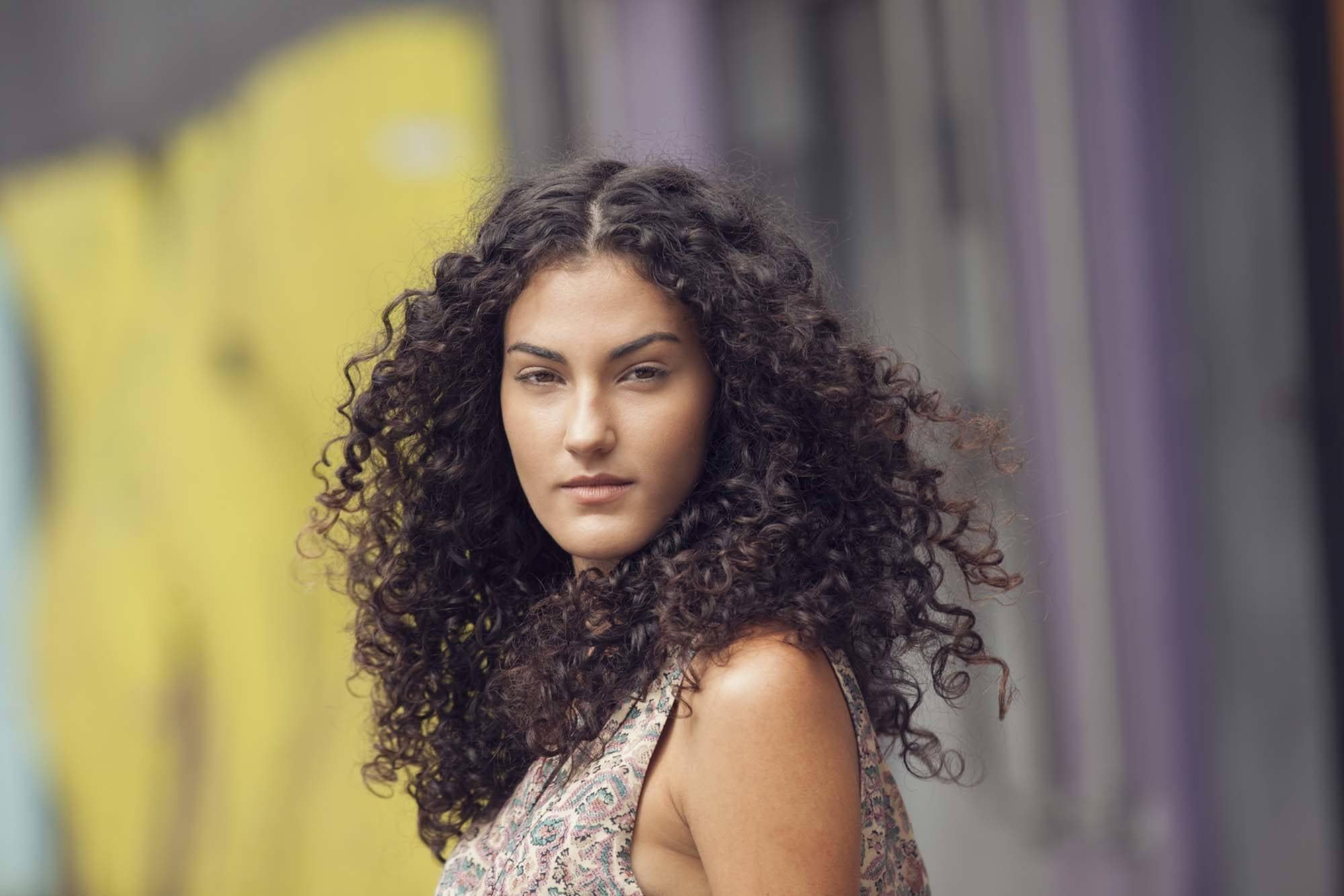 hair smoothing serum on curly hair
