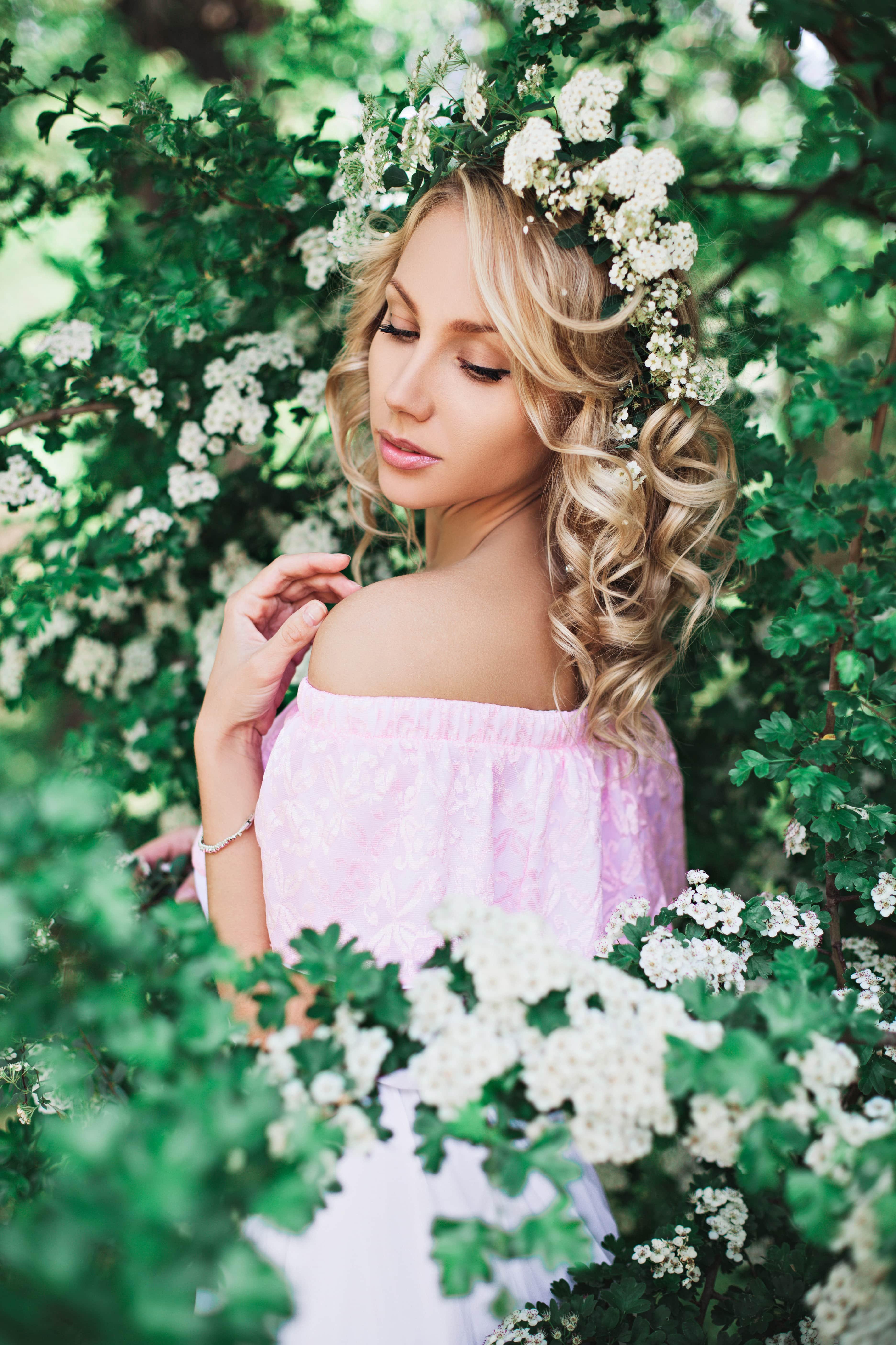 modern perm styles blonde curls floral crown