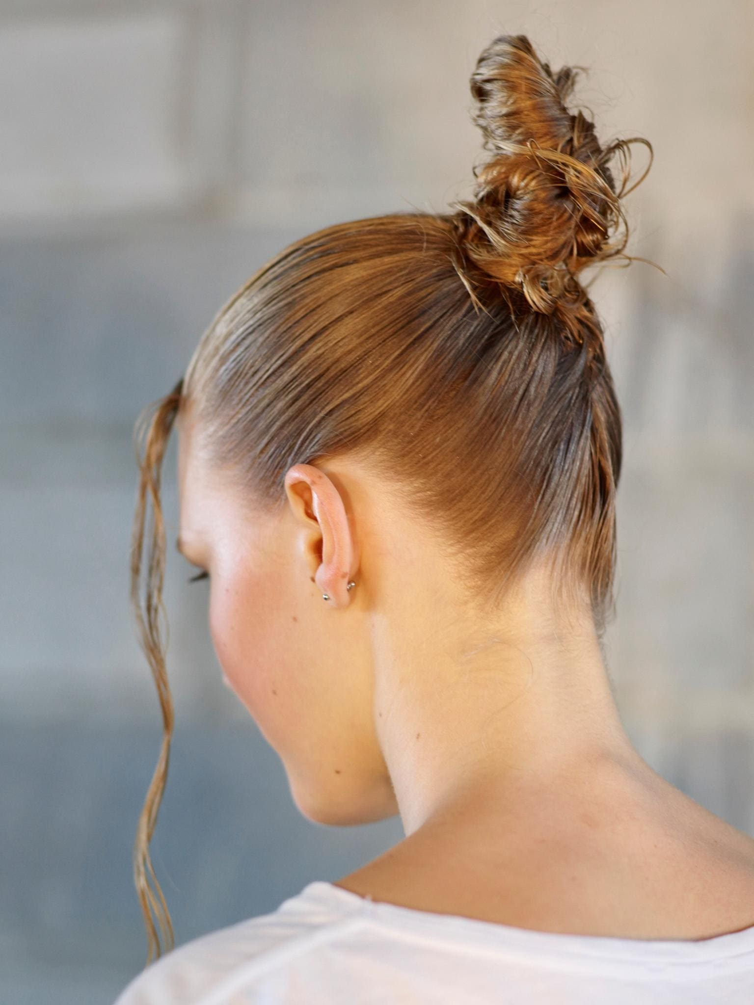 young model with super high top knot hairstyles