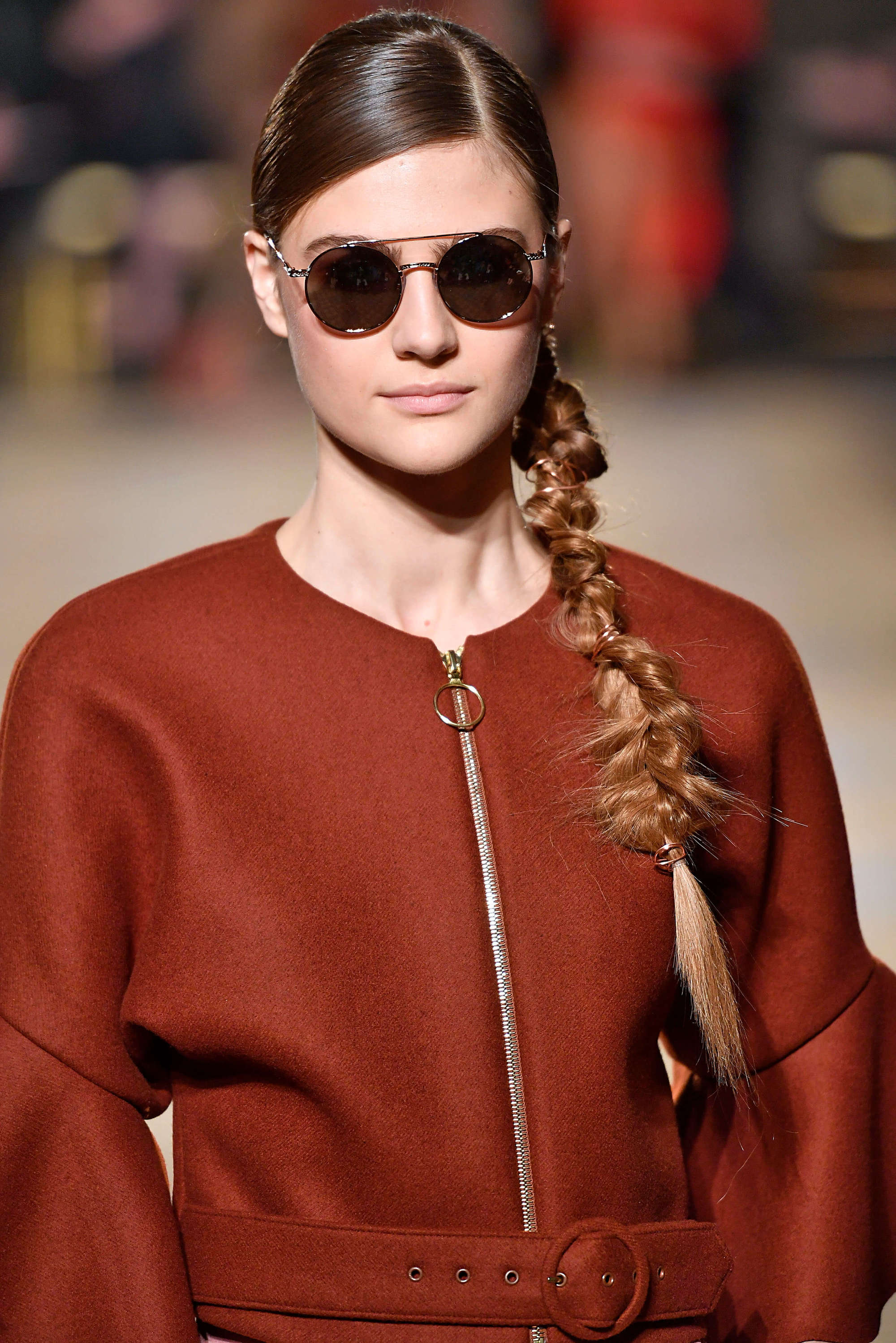 Sleek hairstyles with a side braid from nyfw