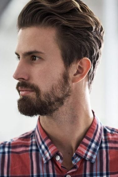 curly men's undercut hairstyle: extra long fade