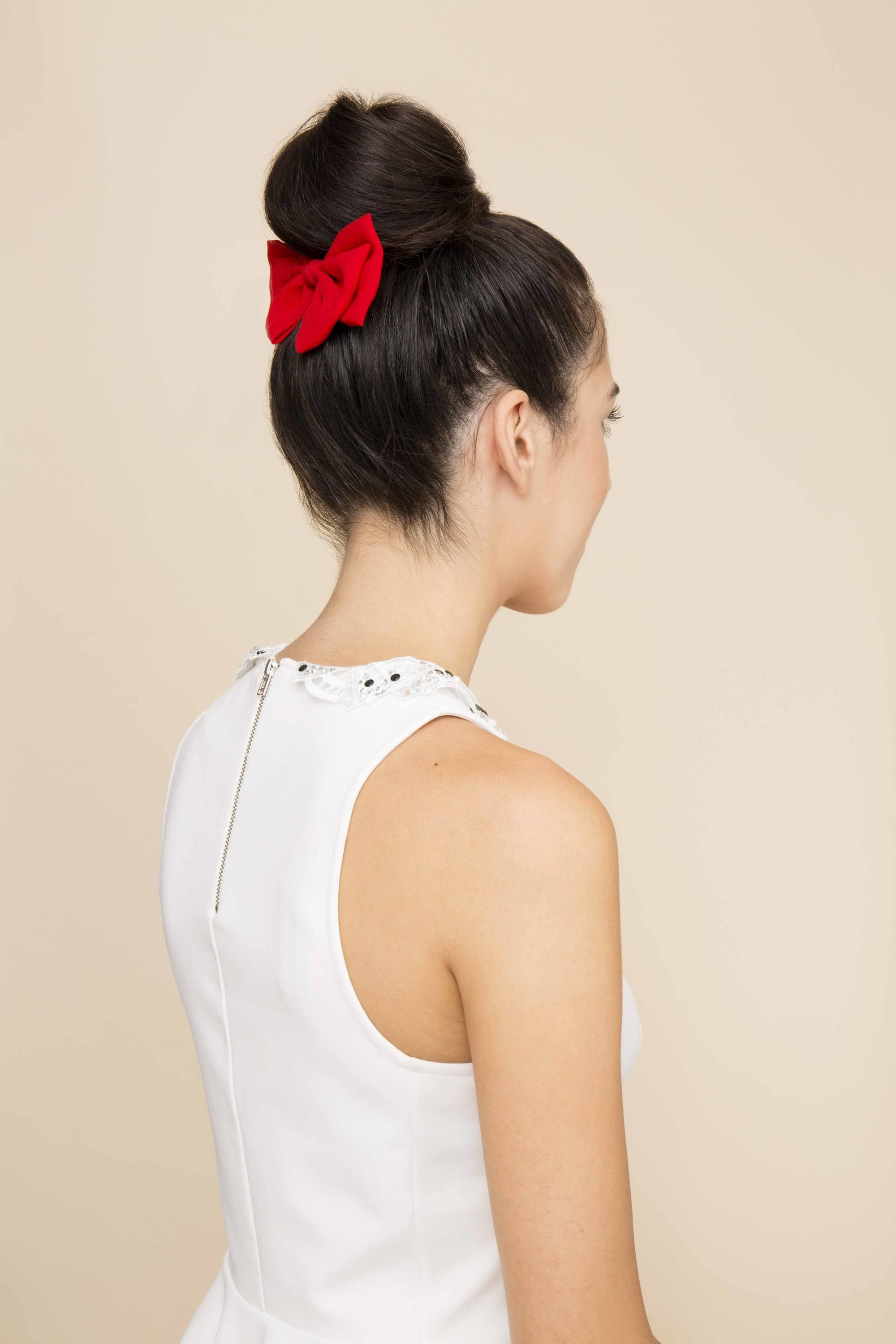 Bows and buns are perfect quirky hairstyles match!