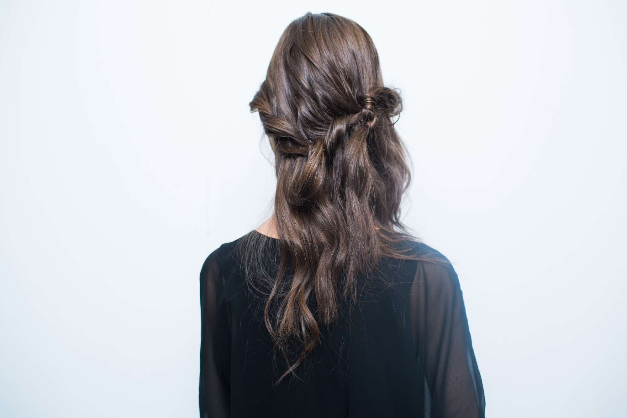 how to create the romantic knotted bang from NYFW