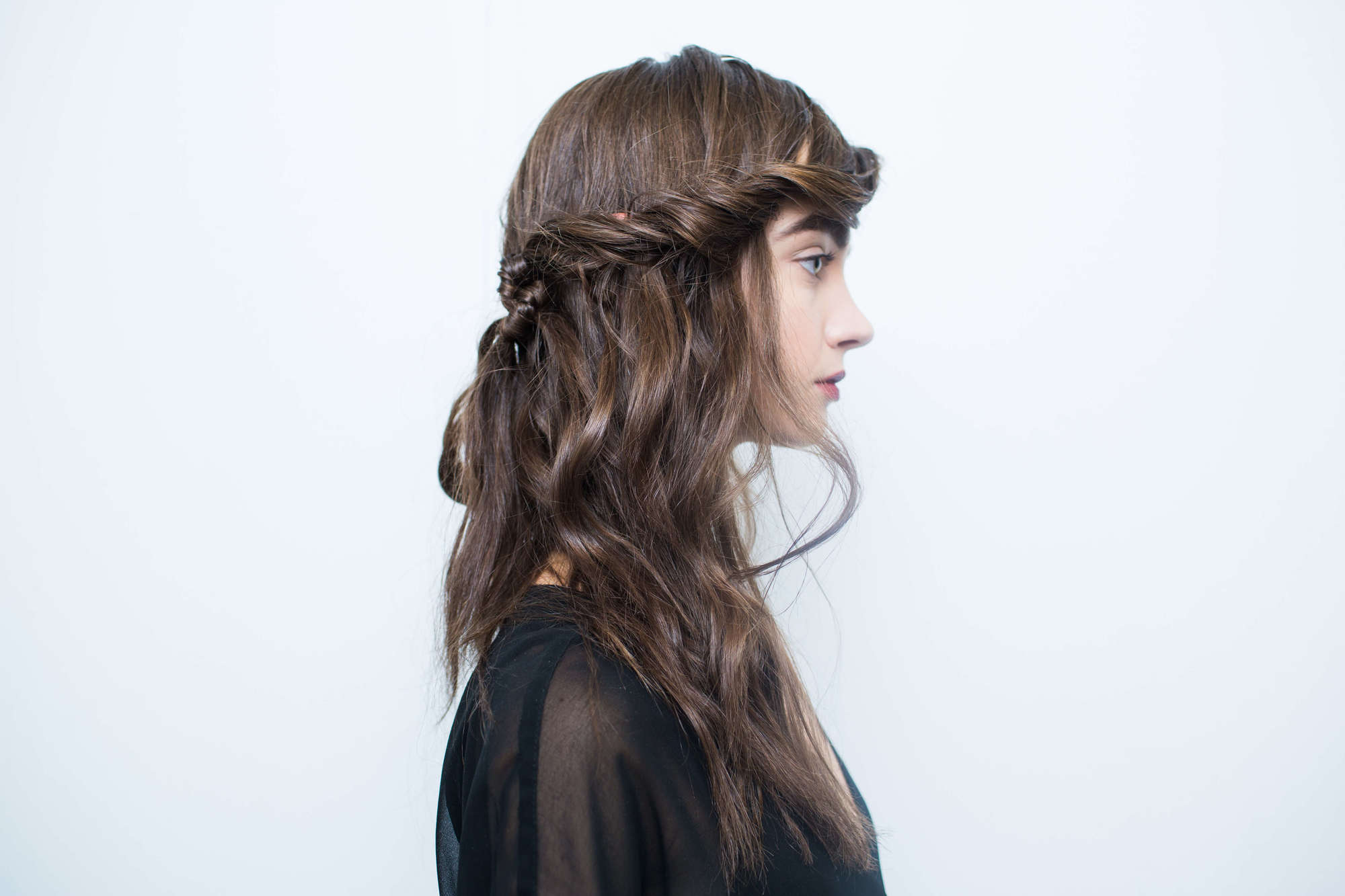 Style Layered Hair By Creating A Chic Side Twist