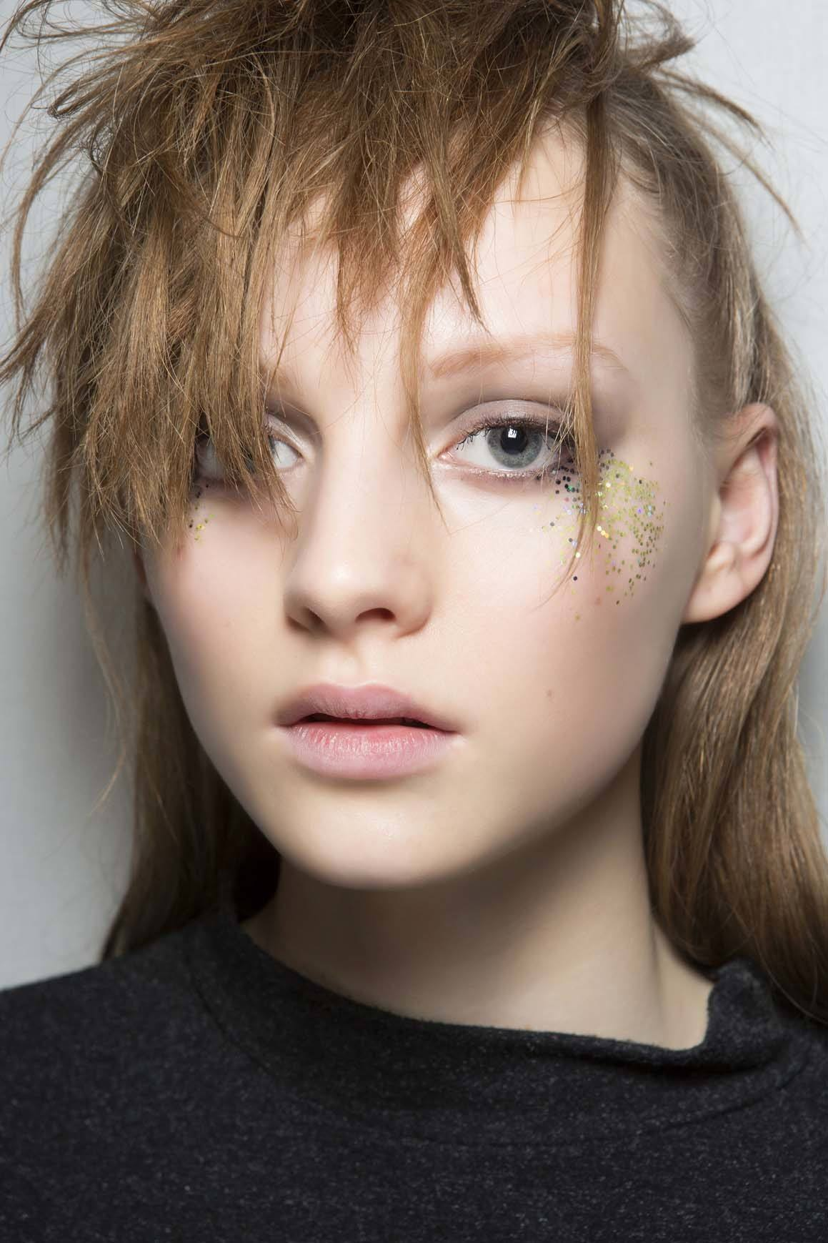 Style Layered Hair By Adding In Feathery Bangs