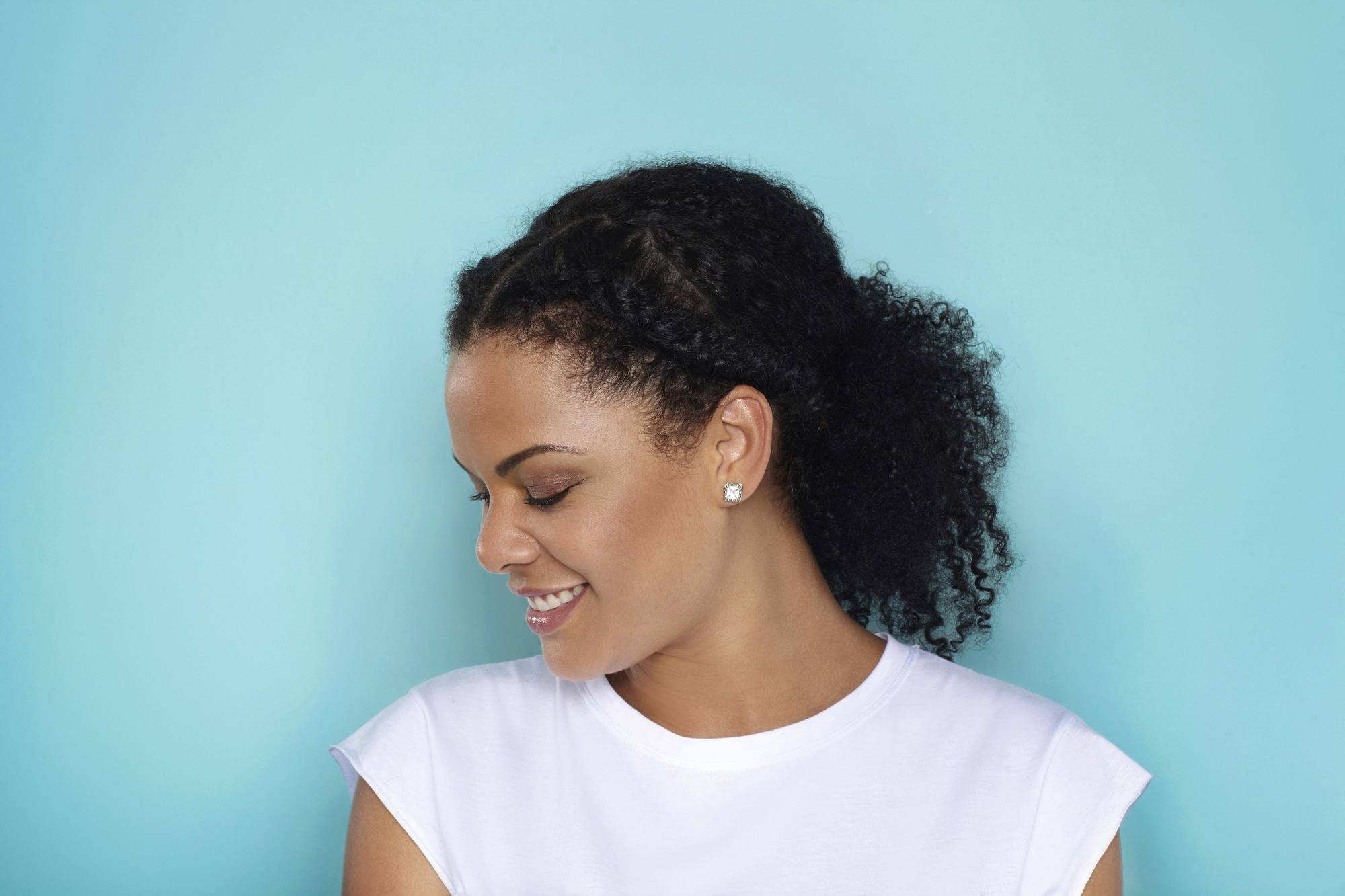 after-party hairstyles included braided low ponytail looks.